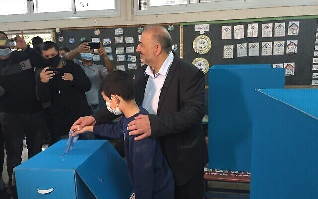 Ra'am party leader Mansour Abbas votes in the Knesset election in Maghar, March 23, 2021. (Aaron Boxerman/Times of Israel)