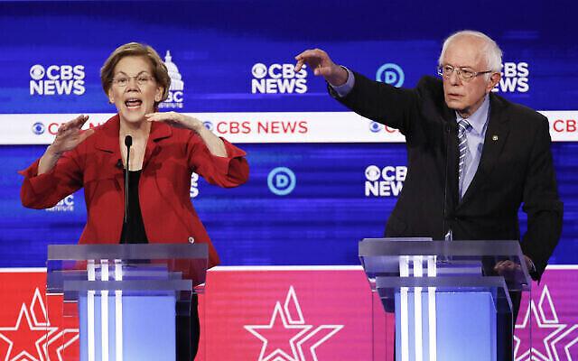 """المرشحان الديمقراطيان للرئاسة ، السناتورة إليزابيث وارن، من اليسار، والسناتور بيرني ساندرز ،  يشاركان في مناظرة  رئاسية للحزب الديمقراطي في مركز """"جيلارد"""" في 25 فبراير 2020 ، في تشارلستون، كارولينا الحنوبية، التي شاركت في استضافتها شبكة CBS News ومعهد كتلة النواب السود في الكونغرس. (AP Photo/Patrick Semansky)"""