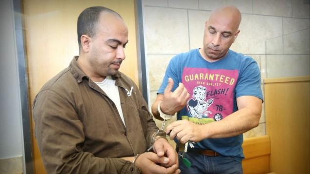 سائق الشفرة المشتبه به يوسف حسين خليفة كما ظهر امام المحكمة 9 يوليو 2014 (فلاش 90)