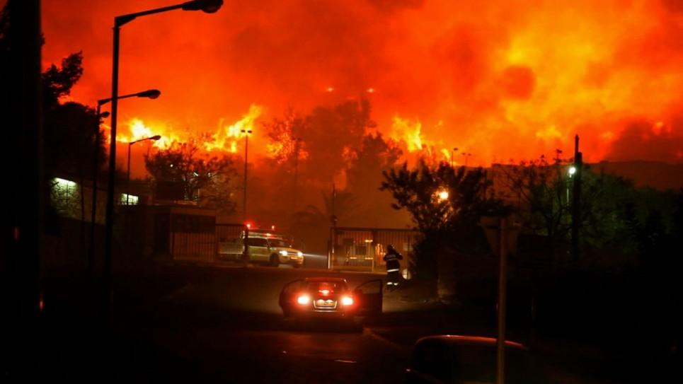 حريق الكرمل انتشر شمال اسرائيل في شتاء 2010. حيث انضم 19 رجل اطفاء فلسطيني الى جهود اخماد الحريق  Courtesy/Firelines