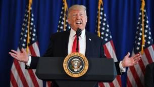 الرئيس الامريكي دونالد ترامب خلال مؤتمر صحفي من نادي الغولف بدمينستر في ولاية نيوجيرزي، 12 اغسطس 2017 (AFP Photo/Jim Watson)