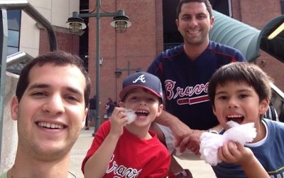 Adam Sonenshine (left) and David Manne take their little PALs to a Braves game.