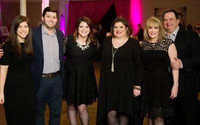 The night's honorees, Maxx Schube and daughters Alana and Rochelle, are joined at the Big Reveal by Alana and Rochelle's brother, Jeremy, and his fiancée, Talia Rachman (left), and their father, Keith Schube. (Photo by Rick Mershon)