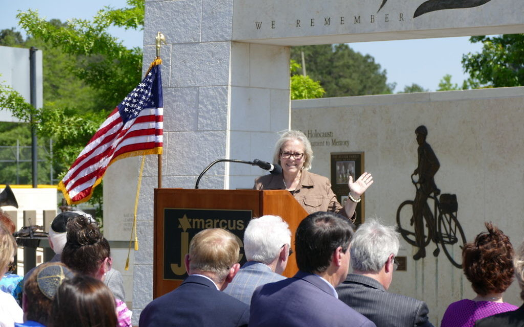 In one example of the consulate's interactions with the community, Ambassador Judith Varnai Shorer speaks at the Besser Holocaust Garden at the Marcus JCC in 2016.