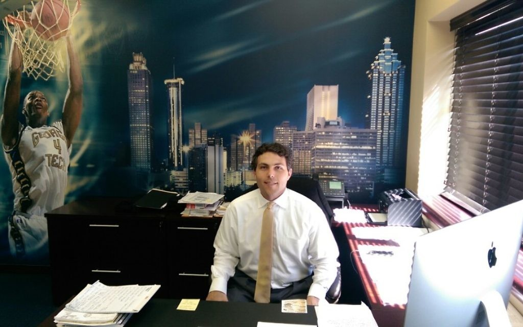 Josh Pastner (pictured in his office) is flying solo at Georgia Tech until he hires assistant coaches. (Photo by David R. Cohen)
