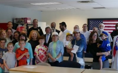 Members of the Toco Hills Jewish community make friends with the DeKalb police July 20.
