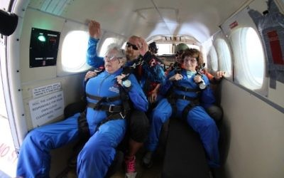 Rose Tucker (left) and Nesie Summers prepare for their 14,000-foot jump out of a plane.