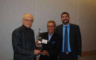 Ken Stein accepts the Opher Aviran Award from Hillels of Georgia President Michael Coles (center) and Executive Director Russ Shulkes in the spring.
