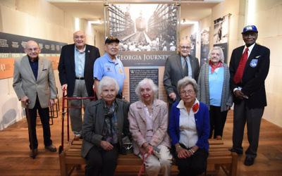"""Nine of the 12 people featured in """"Georgia Journeys"""" attend the opening reception Oct. 23: (from left) Herbert Kohn, Andre Kessler, Jimmy Doi, Tosia Schneider, Tooken Richardson Cade, Jane Tucker, Alton Cadenhead, Louvinia Jordan and Hillard Pouncy. (Photo courtesy of the Museum of History and Holocaust Education)"""