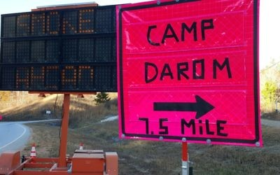 Signs on highway 76 direct drivers to the Ramah Darom retreat center in Clayton which is playing host to wildland firefighters battling the Rock Mountain and Rough Ridge wildfires in North Georgia.