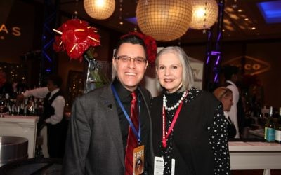 AJFF Executive Director Kenny Blank stands with longtime opening night chair Martha Jo Katz at opening night of the 2017 film festival. The festival returns to the Cobb Energy Centre for opening night and adds closing night there in 2018.