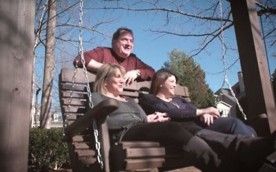 """Keith Schube stands behind wife Maxx and daughter Alana in a scene from """"Schube Strong,"""" showing as part of a program of shorts Jan. 28 and 29."""