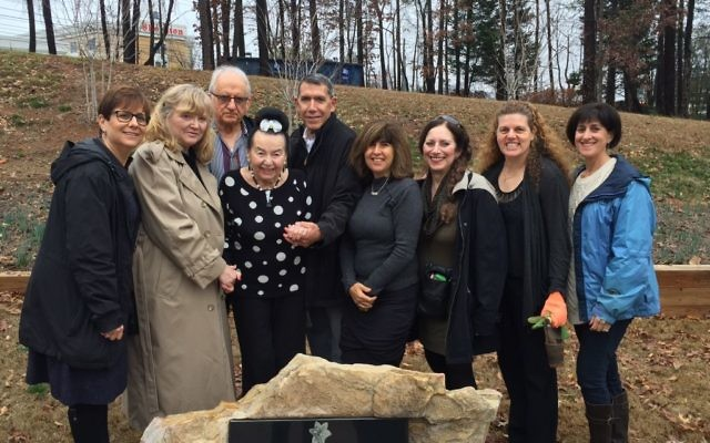 Before Am Yisrael Chai's annual commemoration of International Holocaust Remembrance Day on Sunday, Jan. 22, in Sandy Springs, keynote speaker Magda Herzberger (fourth from left) visits Hammond Park to plant 18 daffodil bulbs as part of the organization's Daffodil Project — an effort to plant 1.5 million daffodils worldwide as a living memorial to the 1.5 million children killed in the Holocaust. Joining Herzberger at Hammond Park are (from left) Nadine Becker, Monica Wolfson (Herzberger's daughter), Ben Klein, Michael Weinroth, Lisa Friedman, Janie Cohen-Legge, Am Yisrael Chai founder Andrea Videlefsky and Gail Dunner.