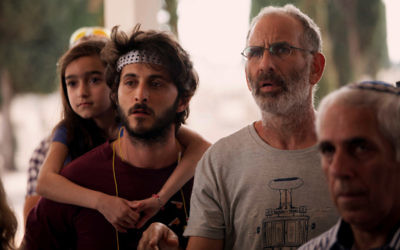 """Zooler (Tomer Kapon, left) supplies the pot to Eyal Spivak (Shai Avivi) and the only laughs to """"One Week and a Day,"""" being shown Jan. 29 and 31 and Feb. 15."""