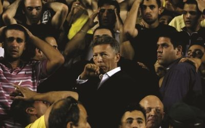 "Beitar Jerusalem owner Arcadi Gaydamak stands among the fans during the drama of ""Forever Pure,"" playing Jan. 29 and 31 and Feb. 11."