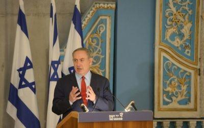 Israeli Prime Minister Benjamin Netanyahu speaks at a Yad Vashem commemoration Jan. 26. (Photo by Amos Ben-Gershom, Government Press Office)