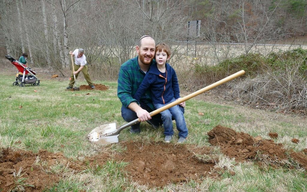 During a Tu B'Shevat retreat at Ramah Darom in 2017, participants help plant a fruit orchard.