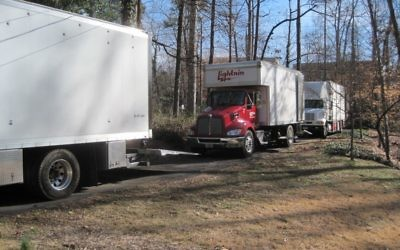 Trucks line up in the Antopolsky driveway for a movie shoot Feb. 13.