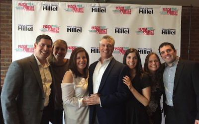 Family members joining honoree Bob Wilensky (center) at the Buckhead Theatre are (from left) Michael, Amy, Ava, Meredith, Haley and Kevin Wilensky.