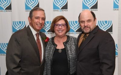 Chuck and Bonnie Berk join Jason Alexander, the evening's emcee, at the International Prime Minister's Club Dinner in Miami Beach on Feb. 12, 2017.