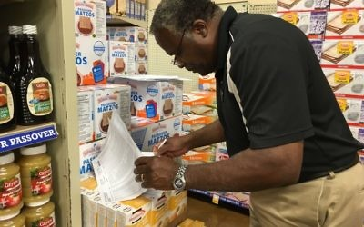Photo by Leah R. Harrison Moses Bester is checking the Passover inventory list twice at the Kroger at the Toco Hill Shopping Center.