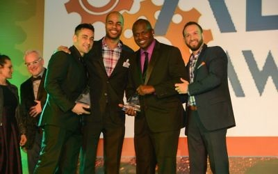 (From left) Jason Kagan, Edrick Ramsay, Byron a Cooper and Aaron Payes celebrate Kagan Entertainment's double win at the Allie Awards.