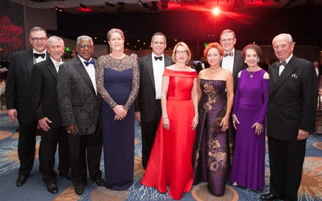 Attending the White Coat Grady Gala are (from left) Grady President and CEO John Haupert, Bryan Brooks, Eddie and Jan Meyers, Ned and Renay Blumenthal, Sherry and David Abney, and Ada Lee and Pete Correll.