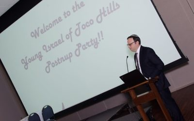 Rabbi Adam Starr welcomes couples to Young Israel of Toco Hills' postnup party Dec. 17.