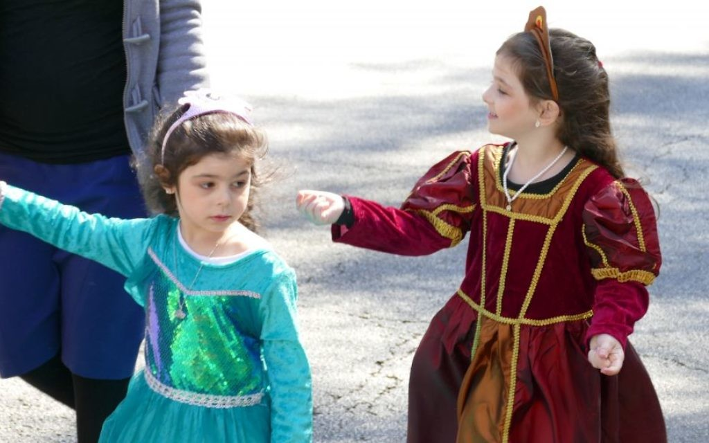 Costumed Esthers put girl power on display each Purim.