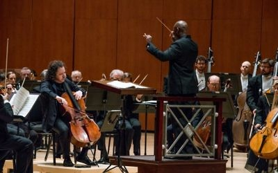 """Cello soloist Matt Haimovitz supports the direction of Atlanta Symphony Orchestra assistant conductor Joseph Young during Ernest Bloch's """"Schelomo."""" (Photo by Elizabeth Nunnally Rawson)"""