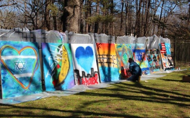 Photo courtesy of the Marcus JCC Teens portray their love of Israel through graffiti art March 19. The resulting eight 4-by-5-foot murals will be on display at the Katz Family Main Street Gallery from April 30 to May 31.