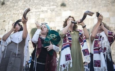 Photo by Daniel Shitrit, Artuz Sheva Members of Women of the Wall blow shofars while holding a Torah they smuggled into the women's space at the Western Wall.