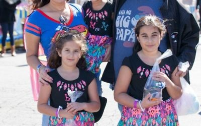 Eti and Chaz Lazarian are teaching daughters Ella (left), Noa and Mia the importance of giving.