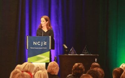 Deborah Danzig accepts the NCJW Lifetime Achievement Award on behalf of Judge Phyllis Kravitch on March 24.