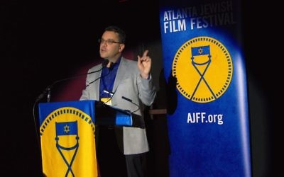 "Festival Executive Director Kenny Blank speaks at the May 11 screening of ""The Wedding Plan,"" an Israeli comedy that kicked off the AJFF Selects series. (Photo by Duane Stork)"