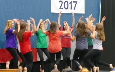 Graduating girls perform a dance they brought back from Israel.