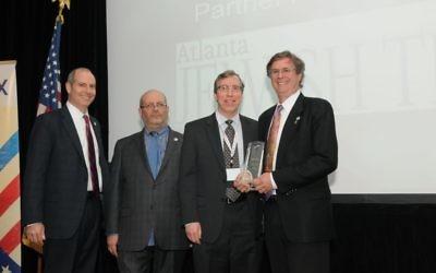 Atlanta Jewish Times Publisher, Michael Morris receives the 2017 Conexx gala award for community partner.