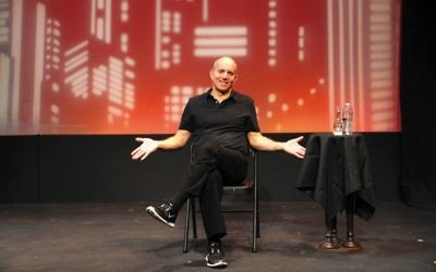 "Brad Zimmerman on stage in ""My Son the Waiter: A Jewish Tragedy."""