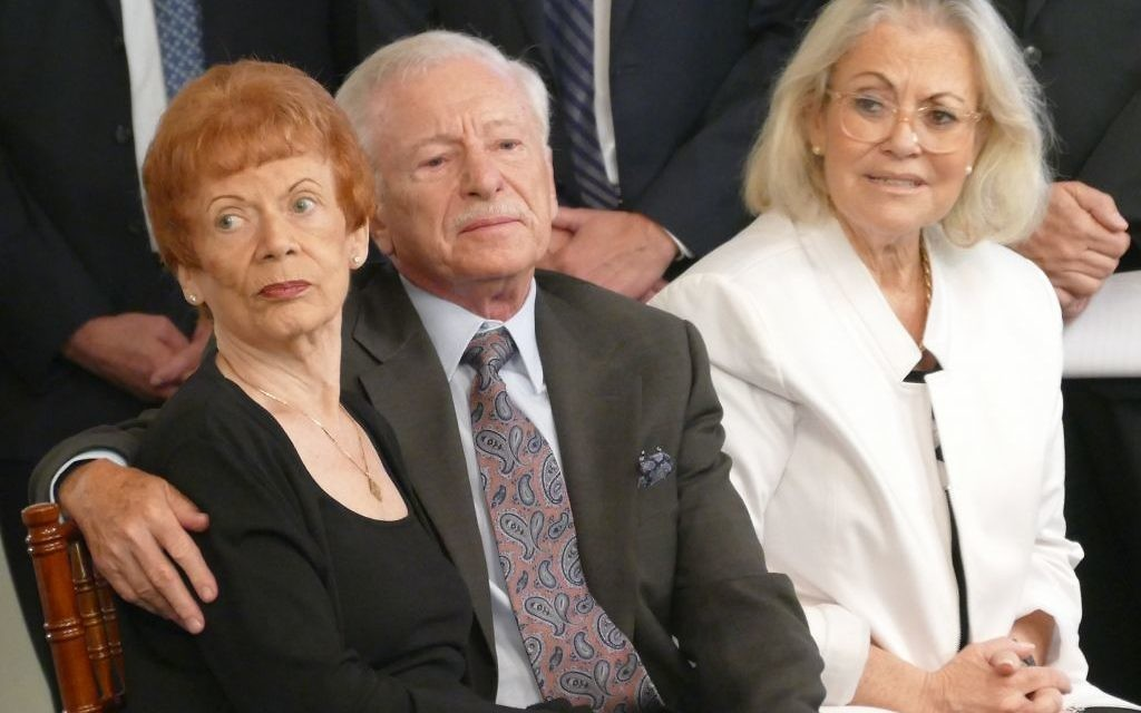 "Holocaust survivors Eva and Robert Ratonyi and Israeli Consul General Judith Varnai Shorer, the daughter of survivors, listen to the Atlanta Young Singers of Callanwolde sing ""Eli Eli"" at the 2017 Georgia Commission on the Holocaust Days of Remembrance ceremony."