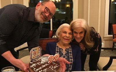Helping Roz Klarman celebrate her 99th birthday are her son, David Klarman of Dunwoody, and her daughter, Ellen Klarman Ackerman, who lives in Los Angeles.