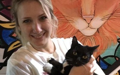 Founder Hadyn Hilton holds Jupiter, one of her favorite Java Cats residents.