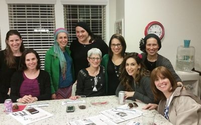 Elana Frank (fourth from right) works with the committee planning infertility sensitivity training. More than 80 mikvah guides and rebbetzins participated in the training.