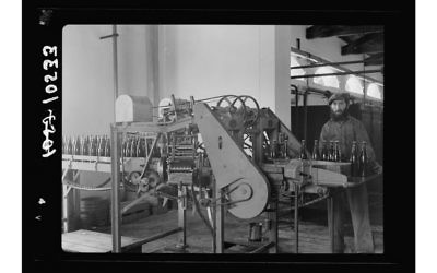 Photo courtesy of the Library of Congress Bottles are labeled at the Palestine Brewery in Rishon L'Zion in 1939.