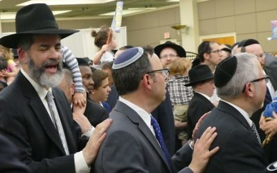 Many local rabbis, such as Young Israel's Adam Starr, join Rabbi Ilan Feldman in the celebration.