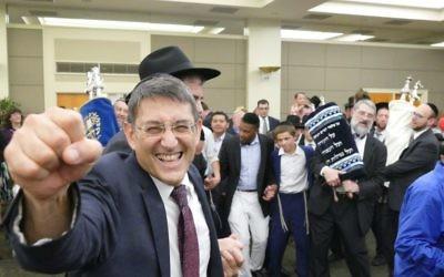 The Atlanta Scholars Kollel's Rabbi David Silverman is at the center of the Torah dancing before the sanctuary dedication.