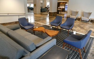 The DoubleTree hotel in downtown Atlanta is in the final stages of retro renovations to honor Dr. Marvin Goldstein who opened the Americana Motor Hotel in 1962, downtown's first integrated hotel. The hotel lobby features midcentury modern furniture.