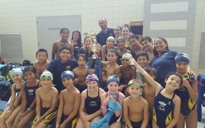 Photo courtesy of the Marcus JCC The Zaban Sharks celebrate their undefeated season.