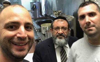 Tip Top Kosher Market owners Yehonatan Hazot (left) and David Malka have Congregation Ner Hamizrach Rabbi Shmuel Khoshkerman in their store.