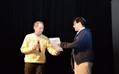 Art Link presents an Enlighten America certificate of achievement to essay contest winner Gabe Weiss of Atlanta Jewish Academy in February 2017. (Photo by Barrie Cohn)
