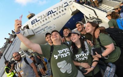 Some of the 70 Israel Defense Forces recruits on the August Nefesh B'Nefesh flight celebrate their arrival in Israel.